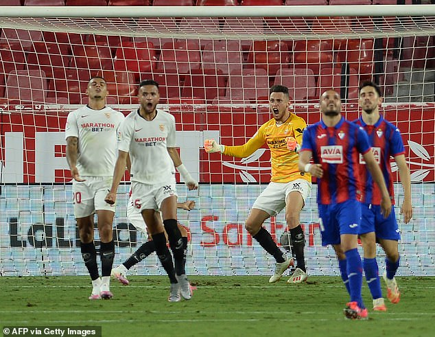 Ocampose (third right) is so dedicated he even went in goal for Sevilla earlier in the season