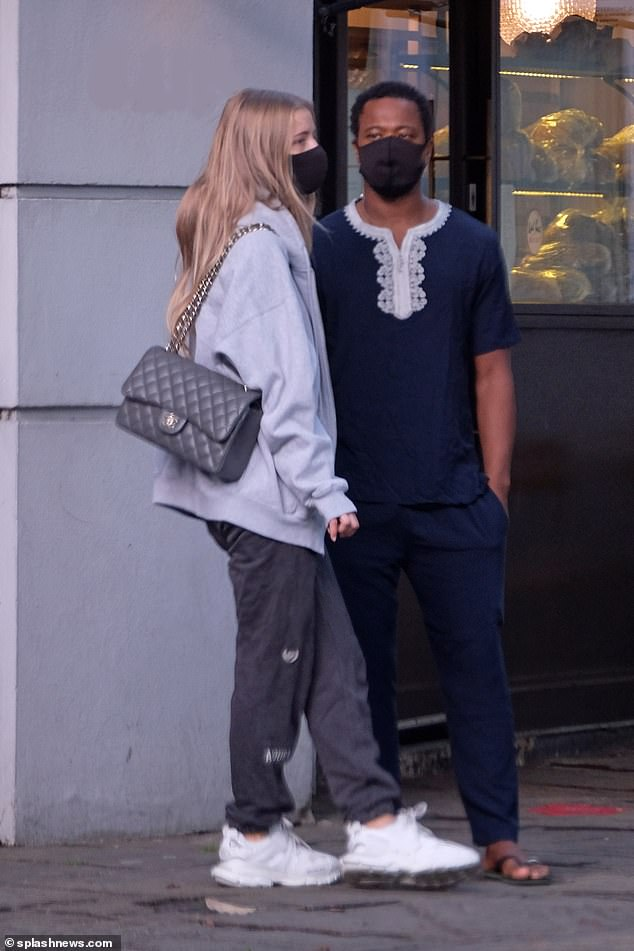 Close: The media personality and model were quick to hide their affection for each other as they shared a kiss on the street