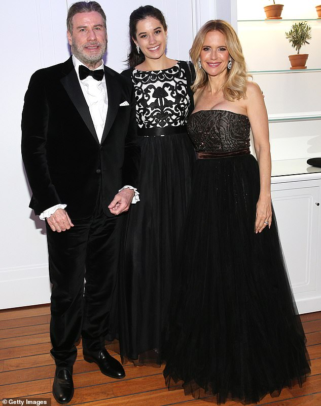 Flashback: Kelly and John were married from 1991 until she tragically died at age 57 of cancer last month at the family home in Florida;  the couple is pictured with Ella in Cannes in 2018