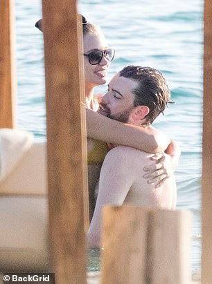 Honeymoon period: The lovebirds couldn't keep their hands off each other as they smooched throughout their time on the beach