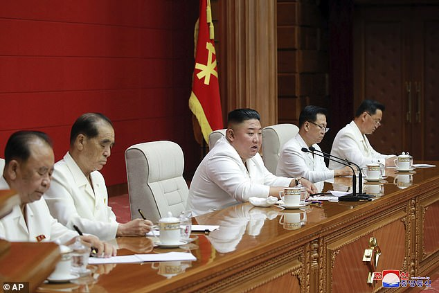 Earlier this week, it was claimed that Kim Jong Un had promoted his sister to North Korea's second in command.  Above, North Korean leader Kim Jong Un, center, attends a Workers' Party plenary meeting in Pyongyang, North Korea, Wednesday August 19