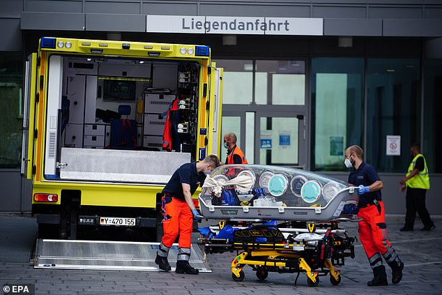 Russian opposition leaderAlexei Navalny is in a coma but 'stable', Charite hospital in Berlin have confirmed. Pictured, the arriving at the German hospital on August 22
