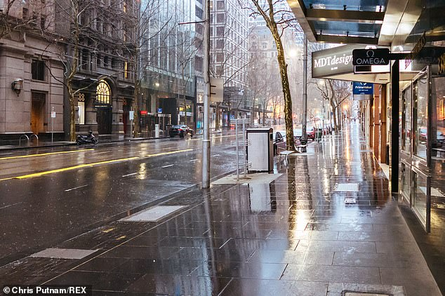 Victoria has reported 94 more coronavirus cases and 18 deaths, the first time the number of infections has fallen below 100 in months.  Pictured: Collins St in quiet, deserted Melbourne's CBD on August 23