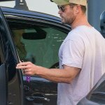 Chris Hemsworth carries injured son with bandages on his hands in Byron Bay