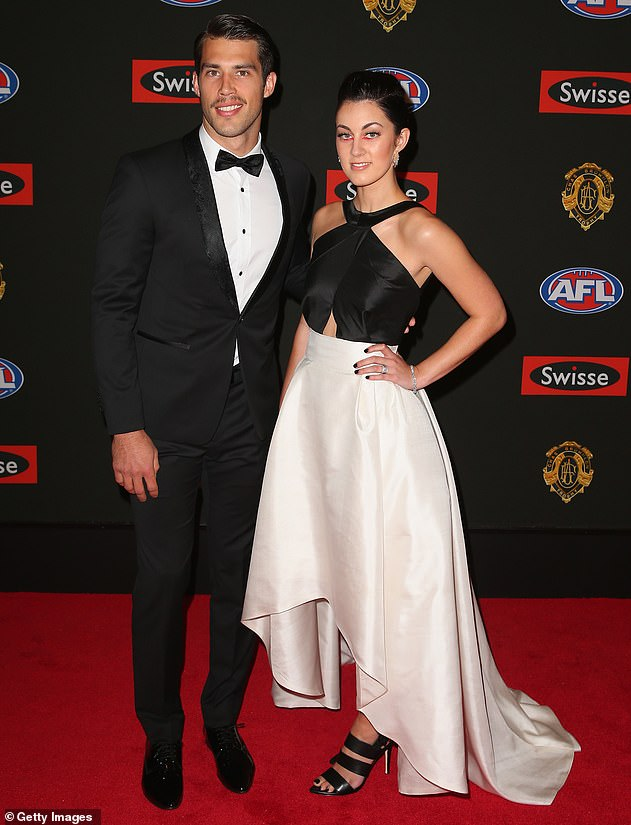 Torn: The 2017 Premiership winner had long spoken of his battle to reconcile the conflicting values of a Jehovah's Witness and the elite sport he played for a living. Pictured with ex-wife Georgia at the Brownlow Medal count in 2014