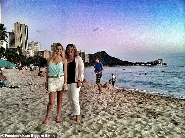 Kate Biggers Smith (pictured right with a family member) is stranded in the United Arab Emirates trying to get on a flight back to Australia