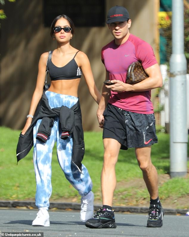 Stepping out: Joey Essex appeared happier than ever as he walked hand-in-hand with his new girlfriend Brenda Santos on Monday as they visited Epping Beauty Clinic in Essex