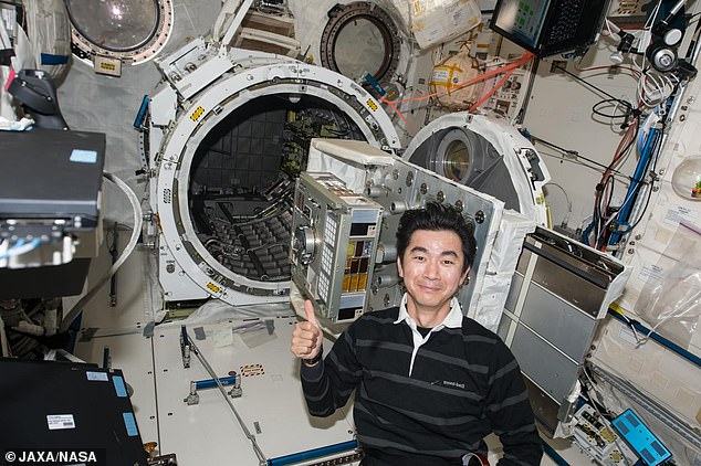 Japanese astronaut Mr. Yugi set up the exposure experiment module ExHAM on the International Space Station to study external bacteria