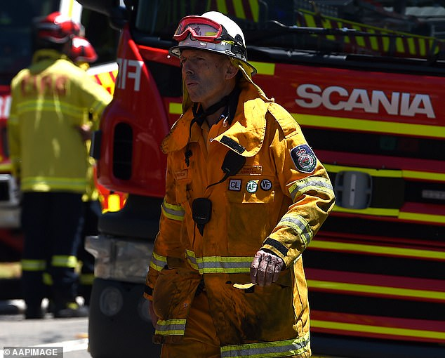 Mr Abbott (pictured working as a volunteer fireman) lost his seat in Warringah, on Sydney's northern beaches, at the federal election in May 2018 and has been looking for a job since then