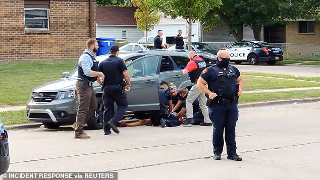 Jacob Blake lies on the street after he got shot following a police shooting in Kenosha, Wisconsin, on Sunday