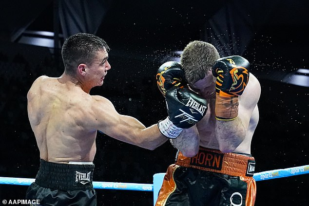 Tim Tszyu (left) lands a vicious uppercut on Jeff Horn who does his best to cover up
