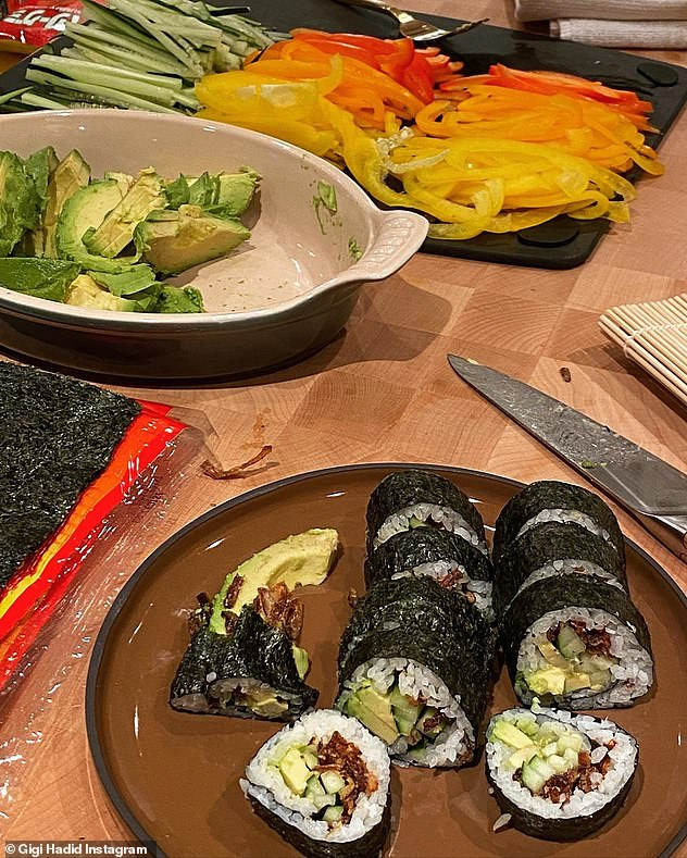 Creative!  The model found a way around the problem of not being allowed to eat raw fish during pregnancy and made vegetarian sushi rolls