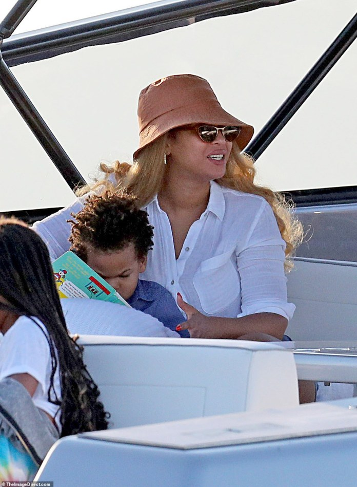 Practical mom: Bey is seen with her son Sir on the boat