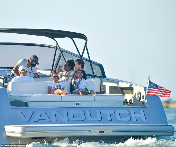 Stay out for the summer: The Carter-Knowles family has been on vacation in the Hamptons for a few weeks