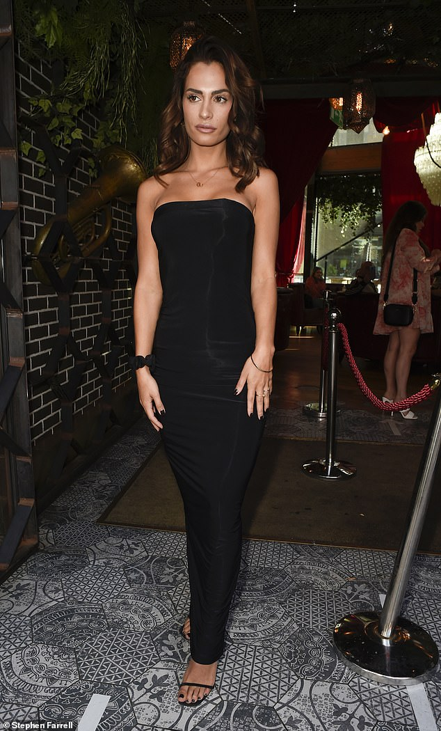 Beauty: Nicole cut an elegant figure in a sleeveless black dress that accentuated her amazing physique