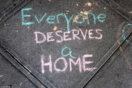 A sign of support is written in chalk on the sidewalk on the Upper West Side in the Manhattan to support the move-in of the homeless population to the neighborhood
