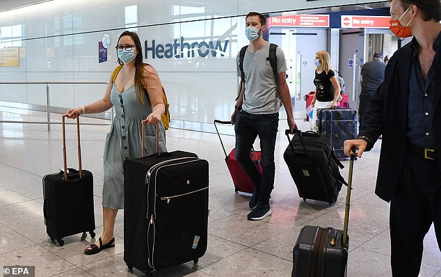 Passengers arrive at Heathrow Airport in London, as it's revealed Border Force only check up to 30 per cent of passengers' locator forms on their return into the country