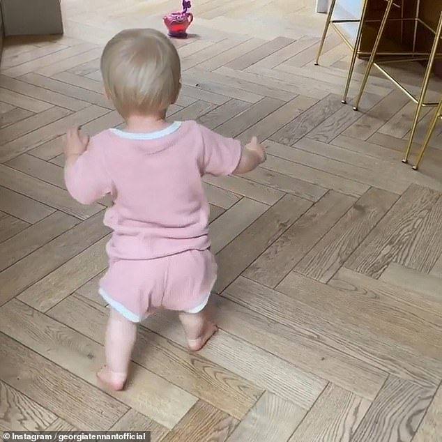 Cute:Birdie looked sweet in a light pink and white shirt and matching shorts, and she was seen slowly making her way to the toy by herself