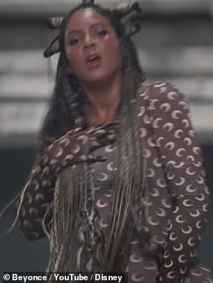Match: Showing her upbeat side, the star made sure to match Beyonce's ensemble in no time by wearing a brown crescent moon print shirt
