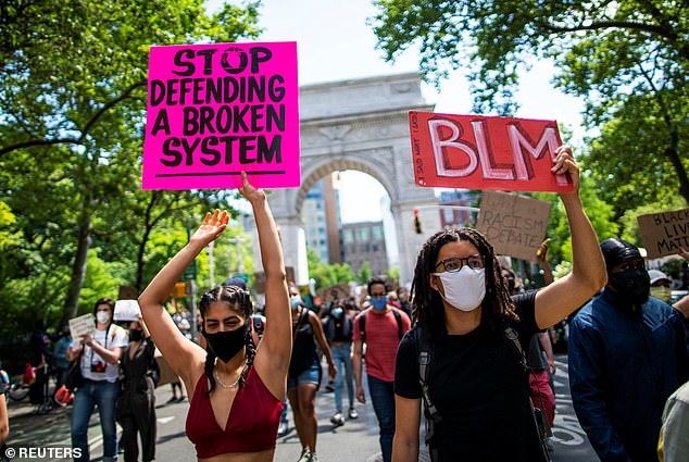 Pictured:Demonstrators march during a protest against racial inequality in the aftermath of the death in Minneapolis police custody of George Floyd in New York City
