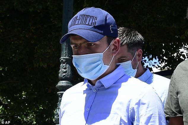 Maguire, wearing a mask, leaves a court building on the island of Syros on August 22 following his arrest on Mykonos