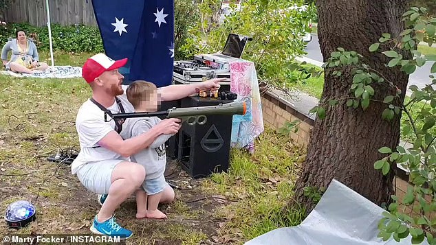 His neighbour (pictured) set up a DJ table and was blasting tunes, billowing smoke from a machine, and helping his toddler fire tennis balls to children on the road