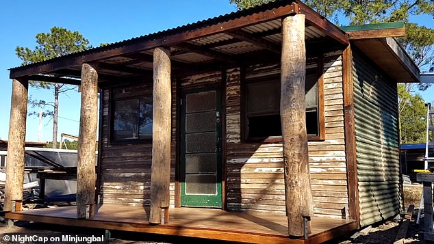 """The website says: 'We are very open """"alternative"""" style dwellings such as Earth-ships, Shipping Container Homes and so forth'. Pictured is an example of a cabin built by a designer who is working on the project"""