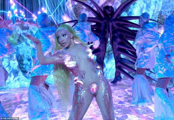 Nude awakening: The rapper wore a Showgirls-style nude body suit with silver detailing