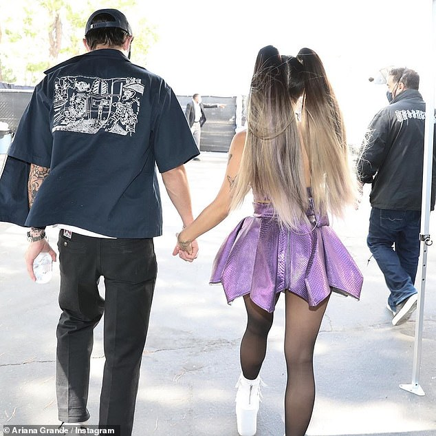 Supportive:The final photo showed Grande exiting the award show's filming venue in her glamorous ensemble with her realtor beau Dalton Gomez by her side