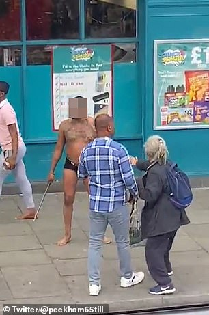 An eye witness heard the commotion on the high street and said the man 'didn't seem aggressive but rather was trying to intimidate someone'