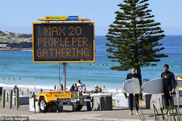 Pictured:A digital display warning beachgoers about COVID-19 restrictions at Bondi Beach in Sydney's eastern suburbs on Saturday