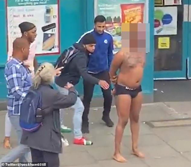 A group of onlookers at one point attempt to rip the knife from his hands when his back is turned but are forced to flee seconds later