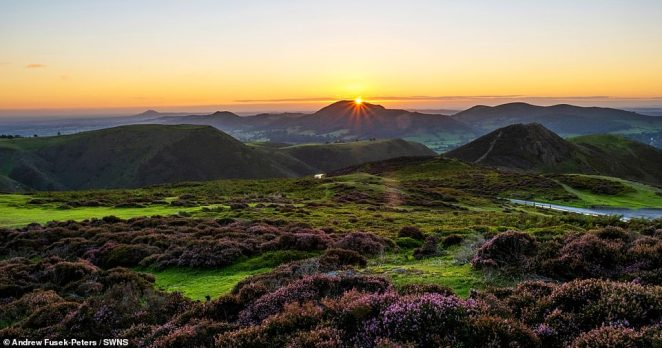 Andrew Fusek-Peters was able to capture the exact moment that sunlight started to rise over Caer Caradoc and its 459-metre summit