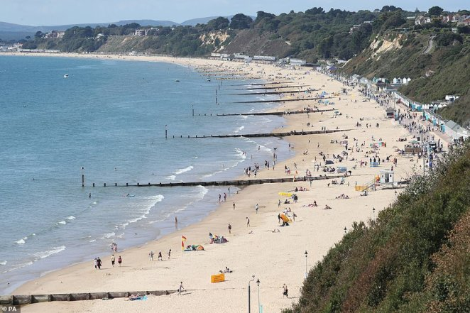 Despite the nippy conditions the sun is still shining around the country which has encouraged people to leave home and enjoy their bank holiday. Pictured: Bournemouth beach this morning
