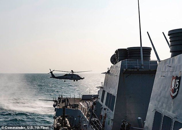 A U.S. Navy warship has transited the narrow and sensitive Taiwan Strait for the second time in two weeks. Above, a file image of a MH-60 Sea Hawk transiting the Taiwan Strait in May this year