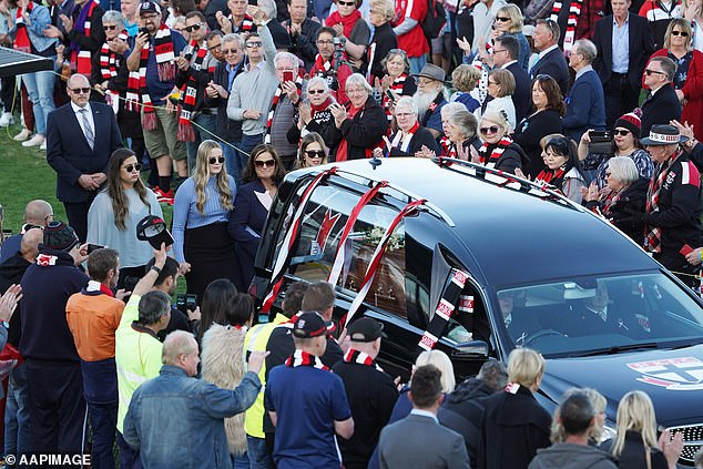 Frawley's family follow the AFL great's coffin during his funeral service on September 18