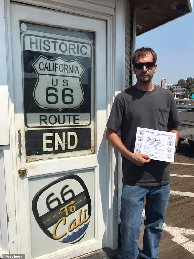Ryan Tebo completed Route 66 this month and is pictured with his certificate in Santa Monica, California