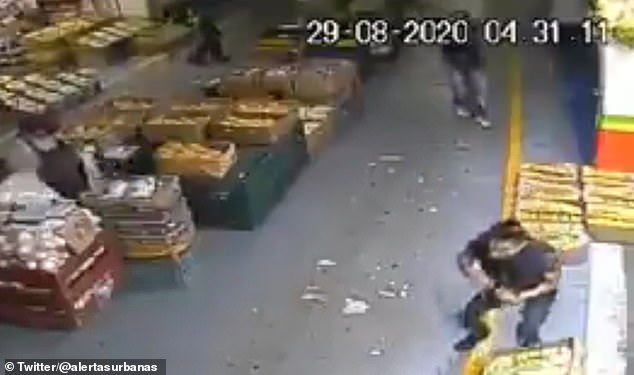 Surveillance camera shows the moment Geramael López (bottom right) was shot dead by a gunman (top right)