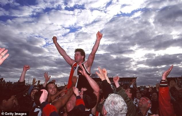 Frawley (centre) is chaired off the ground following his final match in 1995