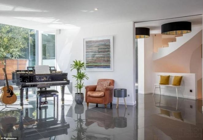 The property is described as a 'rare find' by agents Mishon Welton, and boasts a airy feel, with a grand piano and large windows giving the villa lots of natural light throughout the day