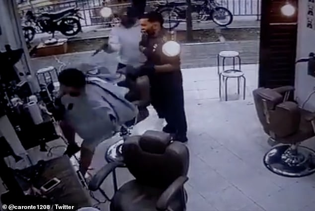 Surveillance video shows the moment the shooter aims and fires his weapon at Carlos Andrés Carmona inside a barbershop in Colombia. Authorities had not made any arrests as of Monday