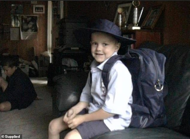 Roan pictured as a young boy at his family's home in Canberra. He would meet convicted paedophile Aaron James Holliday through another boy when he was 13