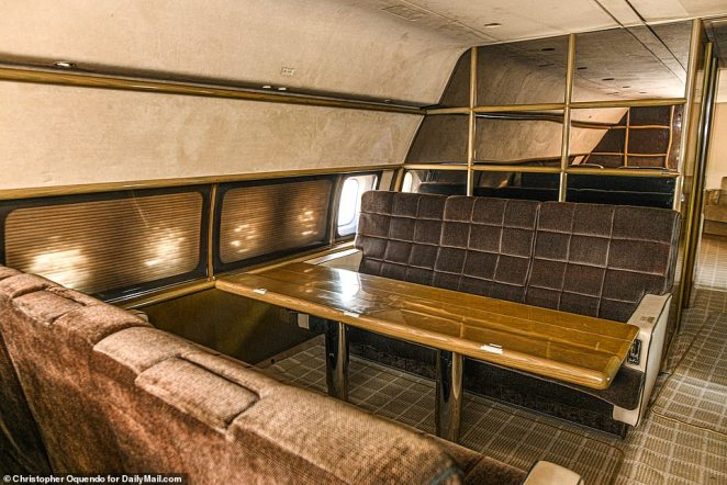 There are numerous creepy pointers to its notorious former occupant, including a garish red couch and mirrored walls (pictured) on the plane