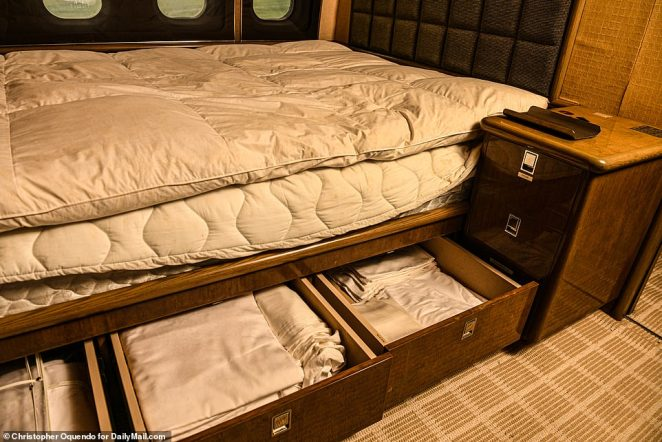 Exclusive images taken by DailyMail.com reveal how Jeffrey Epstein's infamous Boeing 727, the so-called 'Lolita Express' has fallen into disrepair. Pictured: The large bed in the rear bedroom cabin of Epstein's plane that is stocked with extra linens