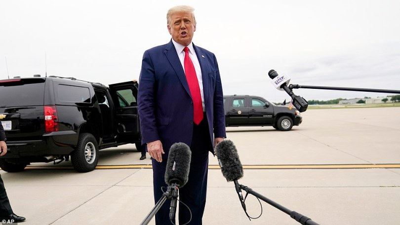 President Donald Trump talks to reporters as he touches down inWaukegan, Illinois, en route to Kenosha, Wisconsin to survey building wreckage and meet with law enforcement
