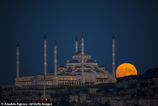 Along with the corn moon, spectators may have a chance at seeing a bright Jupiter and faint Saturn Tuesday night as well. Pictured is the moon overIstanbul, Turkey