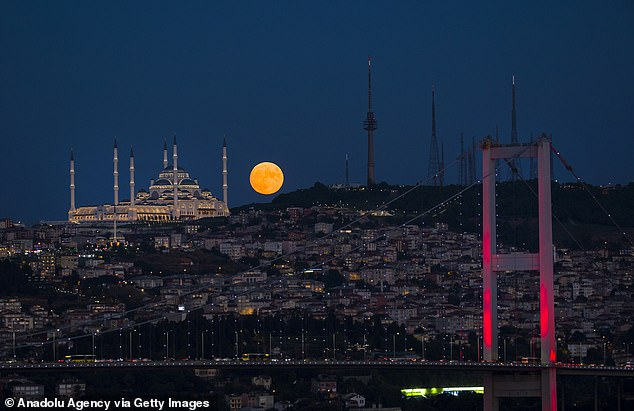 The name was used as it signifies the time corn is typically harvest, but it has also been called the barley moon as barley is ready to be picked. Because the US is inching towards the autumn equinox, there will be shorter-than-usual time between moonrises over the next few days Pictured is the event of Istanbul, Turkey