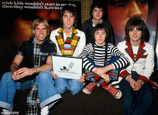 The Bay City Rollers with Derek Longmuir (L) pictured with fellow band members (2L-R) Alan Longmuir, Les McKeown (rear), Ian Mitchell and Stewart Wood