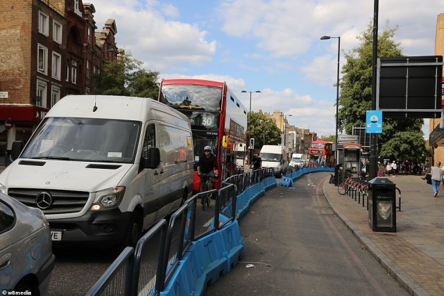 Cars, vans and buses queue along Upper Street in Islington, North London, next to an empty cycle lane at 5pm yesterday