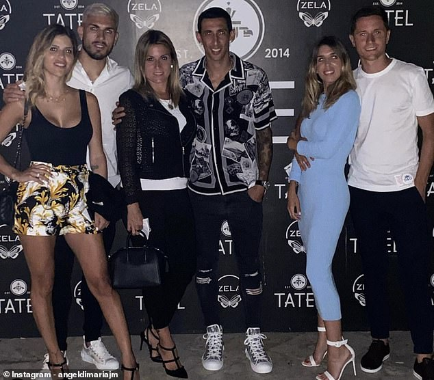 Angel Di Maria (center-right) and Leandro Paredes (second from left) were also in Ibiza on vacation